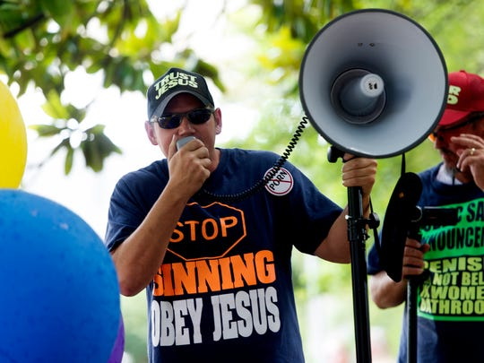 A public speaker talks on his microphone during the annual Knoxville Pridefest parade in downtown Knoxville June 17, 2017.