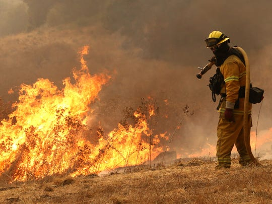 Firefighters work to protect homes along Bennett Valley