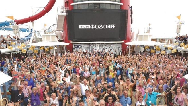 People pack the deck of the Disney Dream during the Sailaway Party during the 2014 Turner Movie Classic cruise