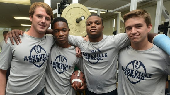 Asheville School senior Jay Evans, second from right, has committed to play college football for Hampden-Sydney (Va.).