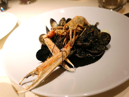 Bomba rice cooked in cuttlefish's black ink with clams, mussels and scampi at BCN Taste & Tradition in Houston.