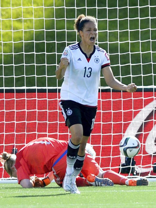 Germany's Celia Sasic (13) celebrates her goal as Sweden goaltender Hedvig Lindahl (1) lies on the pitch during the second half of FIFA Women's World Cup soccer game in Ottawa, Ontario on Saturday. Germany won, 4-1.