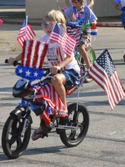 A Star-Spangled cyclist makes his way up Ninth Street