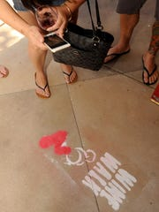 Sidewalk signs lead the way during a previous Wine Walk event in Old Town Camarillo. Now known as the Wine & Beer Walk, it returns Sept. 25.