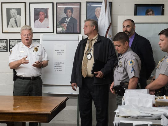 Crisfield Police Chief Michael Tabor points to a table