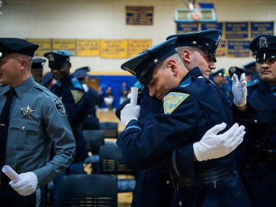 Vineland police officers Daniel J. Chavez, front, and