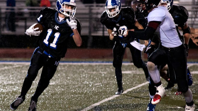 Noah Hayes (11) of Harper Creek in game action Friday night as Harper Creek faces off against Marshall