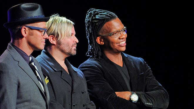 Michael Guido is honored at the Gospel Music Association Honors Celebration at Lipscomb's Allen Arena and presented the award by Toby Mac, Kevin Max and Michael Tait of dc Talk.