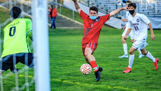 Silver Lake's Sam Dilley charges in and scores the game-winner against Plymouth North.