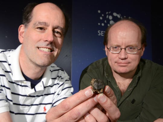 Peter Jenniskens of SETI, left, Scott Harlan of Salinas, pose for a photograph with a meteorite piece Harlan discovered in Misfit Flats, a dry lake bed southeast of Reno, Nevada.
