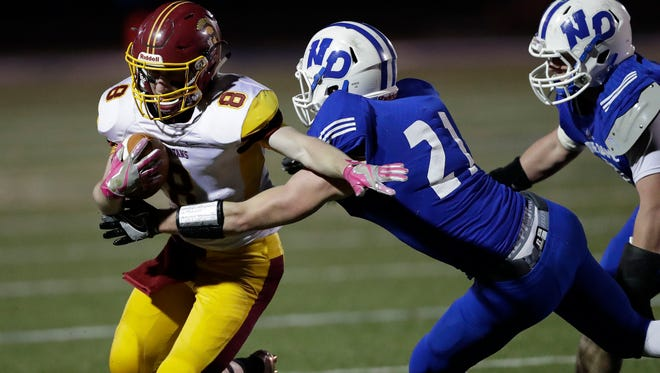 Luxemburg-Casco running back Austin Tlachac runs around end against Notre Dame Academy's Ryan O'Connell during a WIAA Division 3 state quarterfinal playoff game Nov. 4 at Notre Dame..