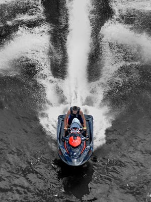 In this file photo, a man on a personal watercraft travels at a high rate of speed north on the Hudson River near the Poughkeepsie waterfront as he approaches the Walkway Over the Hudson.