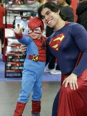Andrew Gecht, 4, dressed as Spider-Man, poses for a photo with Jonathan Andrade, dressed as Superman, at Toy Fair in New York.