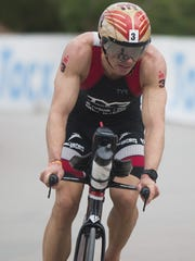 TJ Tollakson (3) bicycles during the Ironman race on
