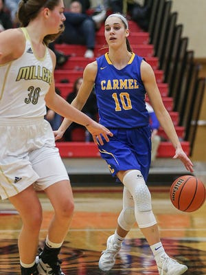 Carmel Greyhounds guard Amy Dilk (10) brings the ball up the court during semifinals action between the Carmel Greyhounds and Noblesville Millers at Fishers High School Friday, Feb. 2, 2018. Carmel won, 50-45.