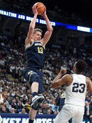 Feb 21, 2018; University Park, PA, USA; Michigan forward Moritz Wagner reaches for the rebound during the first half against the Penn State at Bryce Jordan Center.