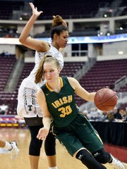 York Catholic's Katy Rader drives against Trinity in the second half of the PIAA District 3 Class 3A girls' basketball championship game Wednesday, Feb. 28, 2018, at the Giant Center. York Catholic lost 62-57 in their second loss in the 13 consecutive district championship appearances.