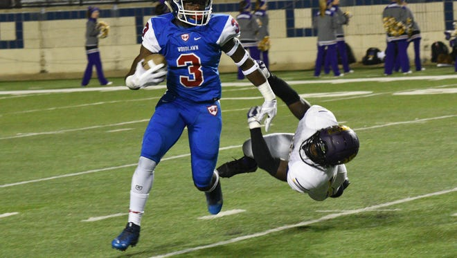 Woodlawn's Trivenskey Mosley runs the ball in their game against Benton Friday at Shreveport's Independence Stadium.
