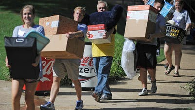 A parade of boxes, clothes and furnishings streams into Becky Bacot Residence Hall at Millsaps College on Friday during Freshman Move-in Day. Staff, uperclassmen and others pitched in to help the first-time students get settled-in.