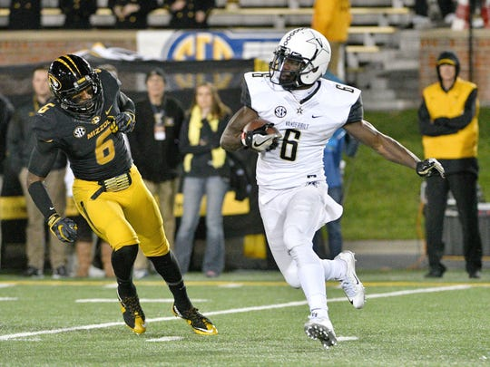 Nov 12, 2016; Columbia, MO, USA; Vanderbilt Commodores wide receiver Darrius Sims (6) runs the ball as Missouri Tigers defensive back Tavon Ross (6) attempts the tackle during the second half at Faurot Field. Missouri won 26-17. Mandatory Credit: Denny Medley-USA TODAY Sports