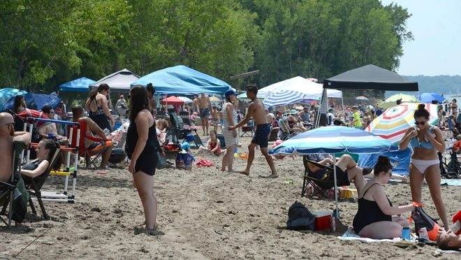 Beachgoers packed Beach 6 at Presque Isle State Park on July 4, when the high temperature in Erie reached 84 degrees, according to National Weather Service in Cleveland data.