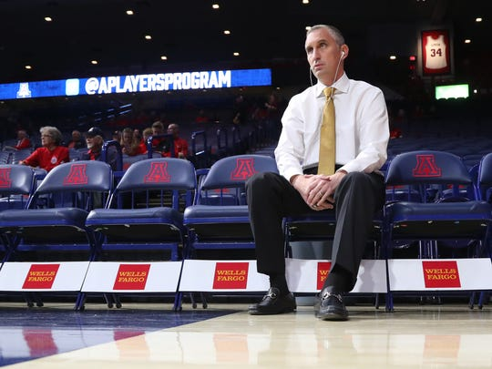 Bobby Hurley sits with his headphones in before December's ASU-UA game at McKale Center.