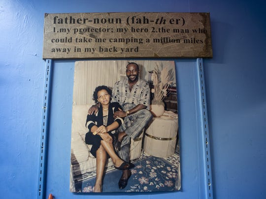 November 10, 2015: A photo of Yvens Bernard and his wife hangs in the back of Yvens' Ft. Lauderdale dry cleaning shop. Yvens describes Josette as a beautiful wife, who worked tirelessly. He laughs, recalling that she almost gave birth twice in their dry cleaning shop, because she worked until the very end.
