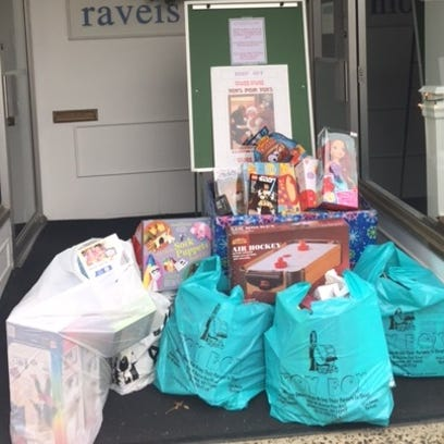 Donated toys have piled up outside the William Raveis