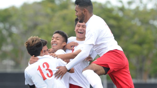 The winning hasn't subsided for the Hueneme High boys soccer team, shown celebrating a goal during last year's ride to the CIF-SS Division 2 semifinals. Defender Diego Caballero (right) is the Vikings' only returning starter.
