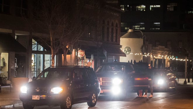 Traffic on Westbound Mountain Avenue begins to back up as Uber and Lyft drivers wait to pick up passengers after last call, early Sunday morning, March 11, 2018, in Old Town Fort Collins, Colo. Traffic was a little lighter Sunday morning because Colorado State University students are on spring break.