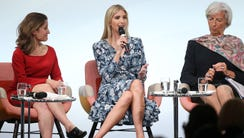 Ivanka Trump speaks on stage next to Canadian Minister