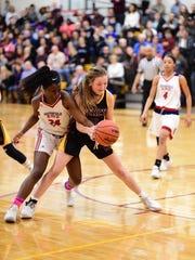 Southfield A&T's Alexis Johnson (24) and Mercy's Jillian Smith vie for the basketball.