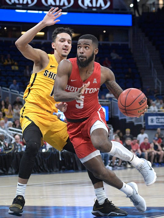 Houston guard Corey Davis Jr. (5) drives to the basket in front of Wichita State guard Landry Shamet (11) during the first half of an NCAA college basketball game in the semifinals at the American Athletic Conference tournament Saturday, March 10, 2018, in Orlando, Fla. (AP Photo/Phelan M. Ebenhack)