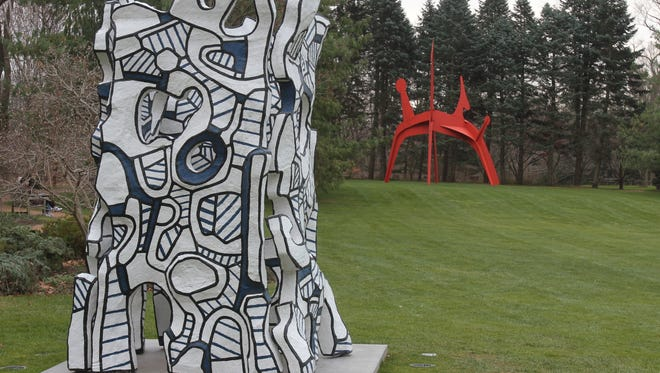 """""""Kiosque I'Evide"""" by Jean Dubuffet at (front) at the Donald M. Kendall Sculpture Gardens on the grounds of PepsiCo in Purchase, photographed Nov. 29, 2012. """"Hats Off"""" by Alexander Calder is seen in the distance."""