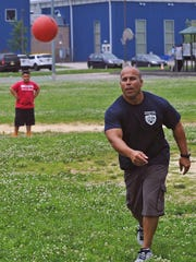 Vineland officer Julio DeJesus pitches the ball for