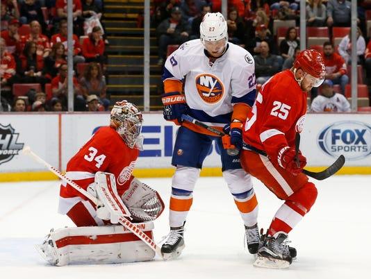636217158446602918-AP-Islanders-Red-Wings-Hocke.jpg
