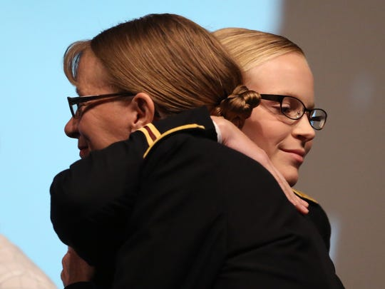 Second Lt. Stephanie Shutak (right) hugs her mom, Ret. Col. Catherine Shutak, during the Texas A&M University-Corpus Christi Islander Army ROTC Commissioning Ceremony on Friday, Aug. 4, 2017. The ceremony marks the transition of graduating ROTC students from cadets to enlisted officers. Each of the five students will be commissioned a second lieutenant in the Army.