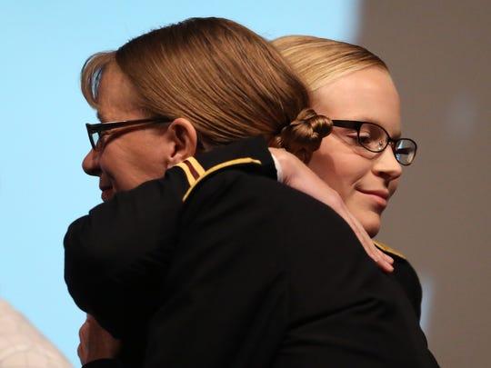 Second Lt. Stephanie Shutak (right) hugs her mom, Ret.