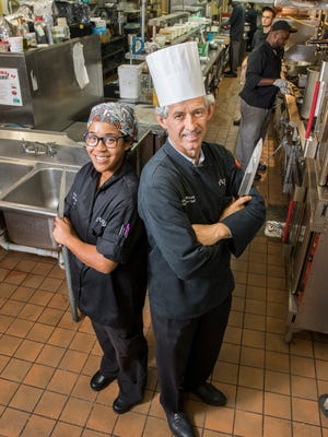 Chef Takara Smith, left, and executive chef Gus Silivos, pose in the kitchen at Skopelos at New World restaurant in Pensacola.  Friday, October 13, 2017.