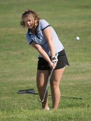 Gulf Breeze High School's Kaylie Herring chips out of the rough and onto the green during Tuesday's District 1-2A Golf Championship tournament at Tiger Point.