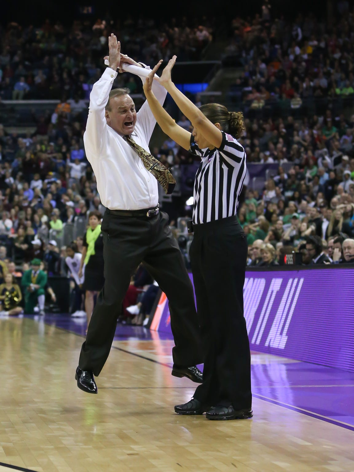 Mississippi State head coach Vic Schaefer leaps into the air to get the attention of a referee during the Bulldogs 2018 trip to the Final Four. Schaefer had baseball coaches holler for his attention all the time when he was an umpire in Texas.