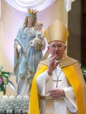 """FILE - In this Friday, May 1, 2020 file photo, Archbishop Jose H. Gomez gives a blessing after leading a brief liturgy at the Cathedral of Our Lady of the Angels in Los Angeles. Federal lobbying records show Gomez, who heads the U.S. Conference of Catholic Bishops, paid a firm $20,000 to lobby the U.S. Senate and House on """"eligibility for non-profits"""" under the CARES Act in 2020."""