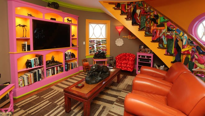 A TV room off of the kitchen in this wildly colorful artists' home in Bronxville, built in 1898 by architect William Bates, photographed Feb. 18, 2015.