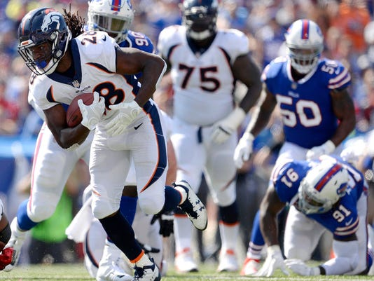 FILE - In this Sunday, Sept. 24, 2017, file photo, Denver Broncos running back Jamaal Charles (28) runs with the ball on his way to a touchdown against the Buffalo Bills during the first half of an NFL football game, in Orchard Park, N.Y. Charles envisioned playing his entire career with the Chiefs, retiring from the organization that drafted him. But the business of the NFL put a twist in those plans. Now their career rushing leader is returning to Kansas City with the rival Broncos for a crucial AFC West showdown Monday, Oct. 30. (AP Photo/Adrian Kraus, File)