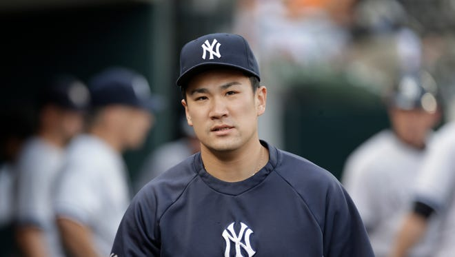 Yankees pitcher Masahiro Tanaka watches from the dugout in the first inning of Wednesday's game against the Detroit Tigers.