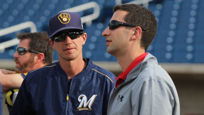 Brewers General Manager David Stearns and Manager Craig Counsell talk before a spring training game in March.