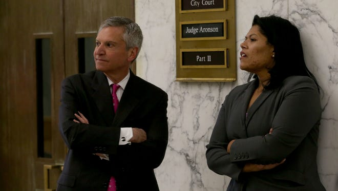 Judge Leticia Astacio and her attorney Edward Fiandach outside the courtroom in March for a hearing.