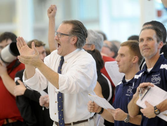 Dallastown swimming coach Rich Howley, left, helped