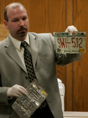 Mark Wiegert with the Calumet Sheriff Department shows the license plates of Teresa Halbach's sport-utility vehicle during a courtroom proceeding in Calumet County on Feb. 16, 2007. Wiegert said he stands by the integrity of the investigation that led to Steven Avery's conviction in the 2005 murder of Halbach.