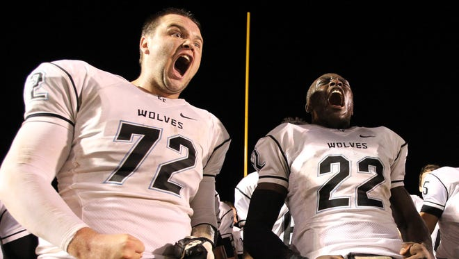 Joe Logan (right) and Ben Bruyer (left) celebrate their win at Northwest Christian School in Phoenix, Arizona on October 30, 2015.